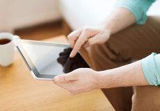 Close up of man with laptop and cup at home Royalty Free Stock Image
