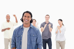 Close-up of a man laughing with people applauding Stock Image