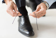 Close up of man leg and hands tying shoe laces Stock Photography