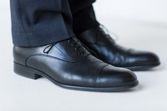 Close up of man legs in elegant shoes with laces Royalty Free Stock Photography