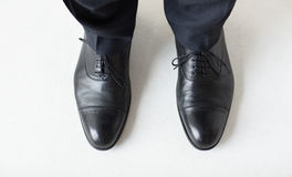 Close up of man legs in elegant shoes with laces Stock Images