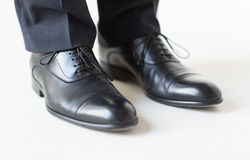 Close up of man legs in elegant shoes with laces Stock Photography