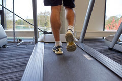 Close up of man legs walking on treadmill in gym Stock Photography