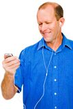 Close-up of a man listening MP3 stock images