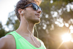 Close-up of man listening to music with earphone Stock Photo