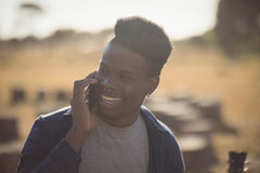 Close up of man looking away while talking on smart phone Stock Photography