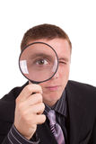 Close-up man looking through magnifying glass Royalty Free Stock Photography