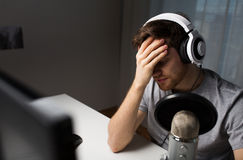 Close up of man losing computer video game Stock Images