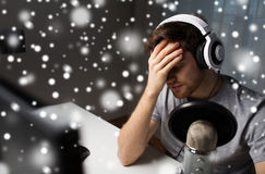 Close up of man losing computer video game. Technology, gaming, entertainment, let`s play and people concept - close up of sad young man in headset with pc Stock Image