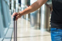 Close-up of a man with luggage in airport while Stock Image