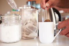 Close Up Of Man Making Tea In Cup Using Teabag Stock Image