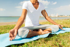Close up of man making yoga exercises outdoors Stock Photo