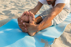 Close up of man making yoga exercises outdoors Royalty Free Stock Photos