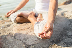 Close up of man making yoga exercises outdoors Royalty Free Stock Photography