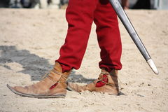 Close up of man in medieval shoes Stock Photos