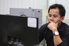 Close up man in office working hard.  Stock Photography