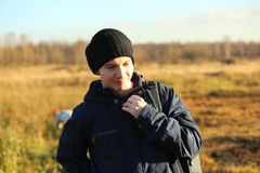 Close Up Of Man Outdoors Walking In Autumn Landscape. Close Up Of Man in a jacket Outdoors Walking In Autumn Landscape looking at camera stock image