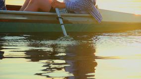 Close-up of man paddling boat. Water ripples and splashes. Stock footage stock footage