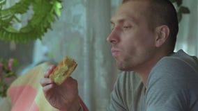Close-up Man Pensively Eats Apple Pie stock video