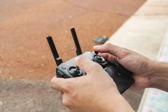 Man play Drone by remote control joystick with smartphone at home as hobby. Close up man play Drone by remote control joystick with smartphone at home as hobby royalty free stock image