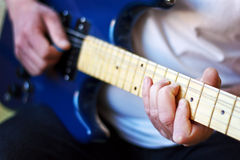 Close up man play an electric guitar Stock Photo