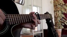 Close up of a man playing the acoustic guitar. Fingerpicking technique with capo on 6th fret stock video footage