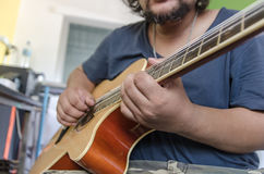 Close up the man playing acoustic guitar Stock Photo