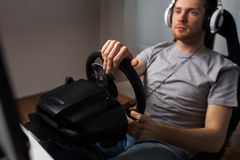 Close up of man playing car racing video game. Technology, gaming, entertainment, let's play and people concept - close up of young man in headphones with pc stock photos