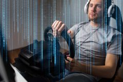 Close up of man playing car racing video game. Technology, gaming, entertainment, let's play and people concept - close up of young man in headphones with pc stock images