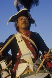 Close up of man playing drum during American Revolutionary war reenactment Royalty Free Stock Image