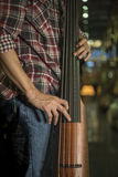 Close up of a man playing electric double bass Stock Image