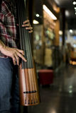 Close up of a man playing electric double bass Stock Images