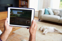 Close Up Of Man Playing Game On Digital Tablet At Home Stock Photos