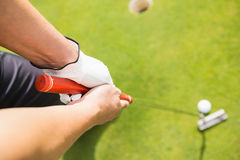 Close up of man playing golf Stock Images