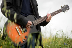 Close up of a man playing guitar Stock Photo