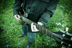 Close up of a man playing guitar Stock Photography