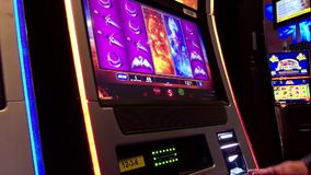 Close up man playing slot machine stock video footage