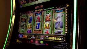 Close up man playing slot machine stock footage