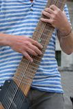 Close up of a man playing an 12 stringed guitar. GHENT, BELGIUM, 25 JULY 2014: Close up of a Unidentified man playing an 12 stringed guitar Royalty Free Stock Photography