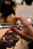 Close-up of Man Playing Trumpet. Close-up of hands as man plays the trumpet Royalty Free Stock Photography