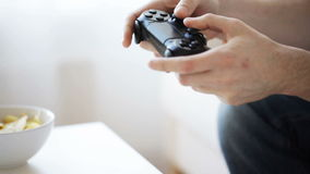 Close up of man playing video game at home stock footage