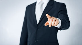 Close up of man pointing finger to something Royalty Free Stock Images