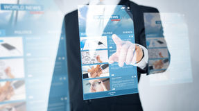 Close up of man pointing finger to world news Stock Image