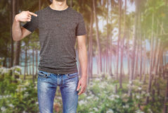 Close-up of a man pointing his finger on his chest (a grey t-shirt). Stock Photography