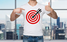 Close-up of a man pointing his finger to the chest with the shooting mark. Royalty Free Stock Image
