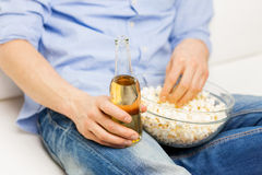 Close up of man with popcorn and beer at home Royalty Free Stock Image