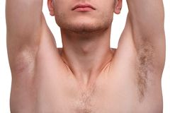 Close-up of a man showing an armpit isolated on a white background. stock photography