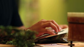 Close up of a man reading a book about herbs and hops stock footage
