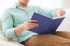 Close up of man reading book at home Royalty Free Stock Photos