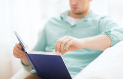 Close up of man reading book at home Stock Photography